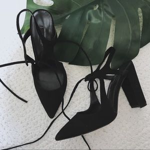 Black suede block heel shoes with straps detail